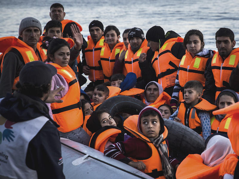 Over 200,000 Syrian refuges, like the ones seen here, crossed the Mediterranean in October. After Friday's attacks in Paris, more than a dozen American governors say they do not want Syrian refugees in their states.