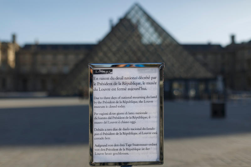 A public notice declares that the Louvre museum is closed for national mourning in Paris, Sunday, Nov. 15, 2015.