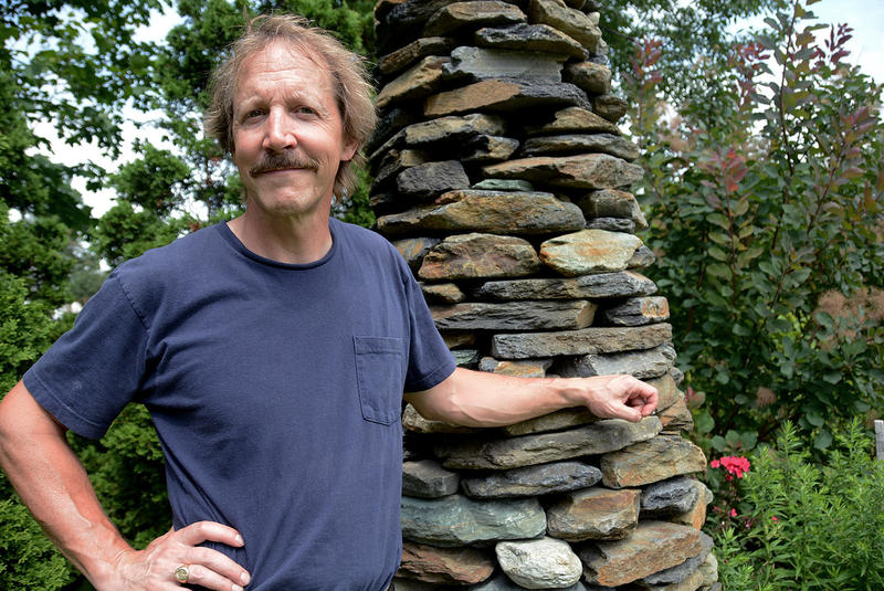 "When he's not playing the jazz mandolin, Jamie Masefield works as a professional dry stone mason. His structures, like this ""Stone Tree"" at his home in Monkton, are free-standing, without anything binding the stones together."