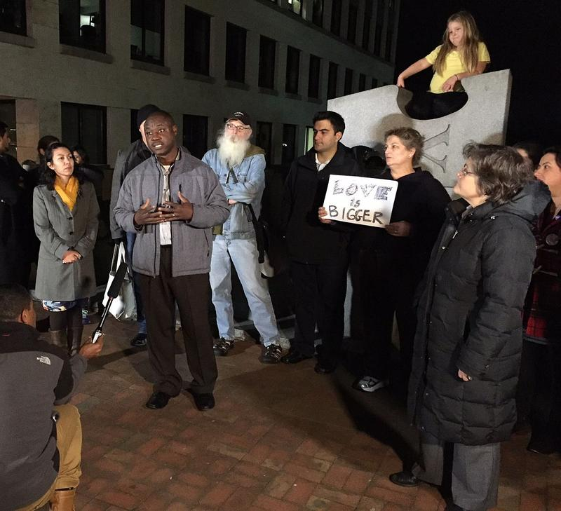 Yacouba Jacob Bogre, second from left, spoke in support of Syrian refugees coming to Vermont on Nov. 19, in Burlington.