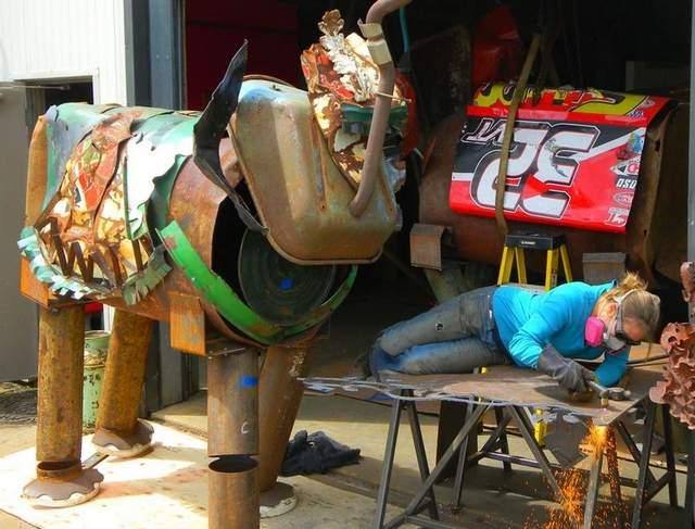 Sculptor Kat Clear works on a collection of life-sized elephants, made from found metal objects.