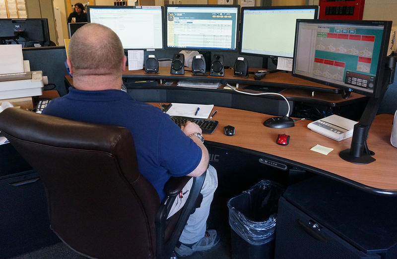 Dispatch Supervisor Fred Cummings sits at his workstation at Capital West Dispatch, in Montpelier.