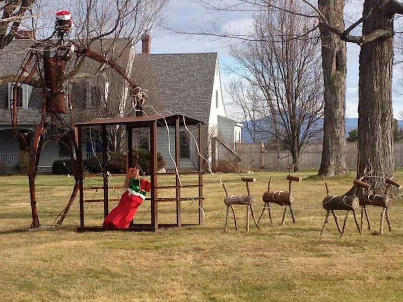 Holiday lawn ornaments, like these in Charlotte, look out of place without the traditional December blanket of snow.