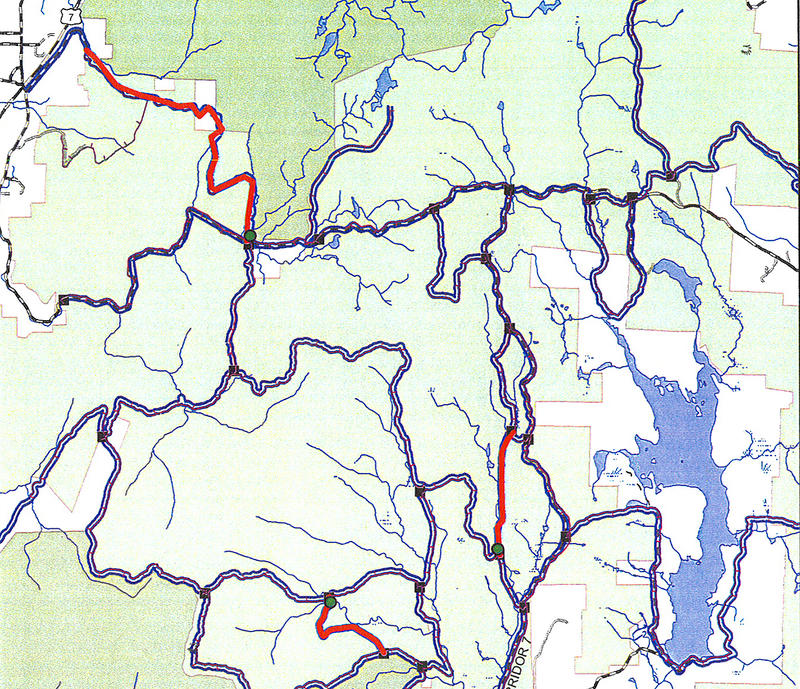 This map details closed snowmobile trails in the southern part of the Manchester District of the Green Mountain National Forest. Closed trails are in red and affected bridges are marked with green dots.