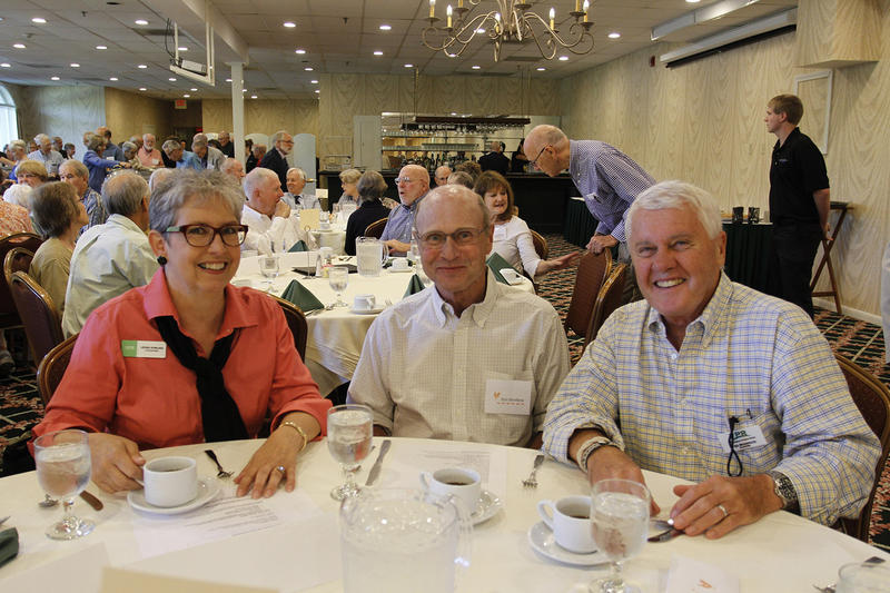 Commentator Leora Dowling, Don Boniface and his husband Ted Boniface at the 2015 VPR Commentator Brunch at The Lake Morey Resort in Fairlee.