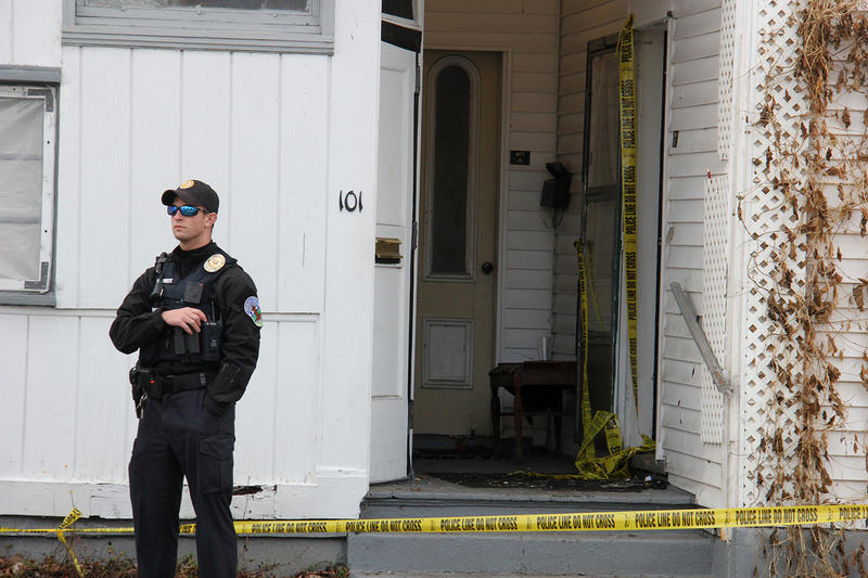 A Burlington Police officer keeps watch outside the building, the morning after Vermont State Police and federal agents shot and killed Kenneth Stephens. Burlington's Police Commission has now raised concerns about how the December raid was executed.
