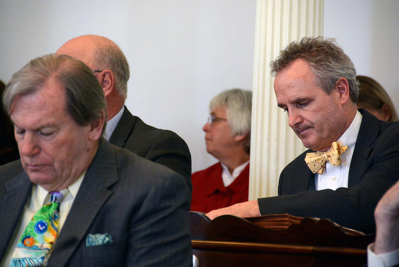 Sen. Chris Bray, right, shown here at the Statehouse in 2014, says lawmakers need to address the outcry from constituents opposed to large solar and wind process in their towns.