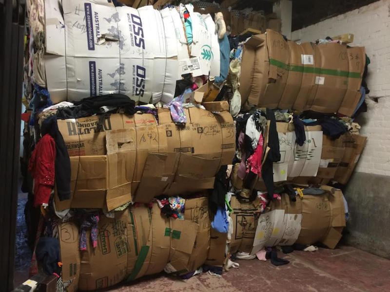Unsold clothing from around Southern Vermont sits in bales in a Bellows Falls warehouse, ready to ship out. Lately, the cost of textiles has dropped from 16 and a half cents to two cents a pound, putting thrift shops in an economically difficult position.