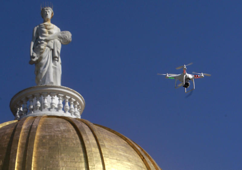 A drone flies over the Vermont Statehouse in this file photo. The FAA says new, long-awaited rules on the use of commercial drones are the first step toward fully integrating drones into U.S. airspace.