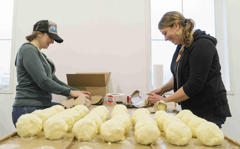 Alex Fetherolf (left) and Marisa Mauro (right) packaging butter at the Ploughgate Creamery in Fayston.