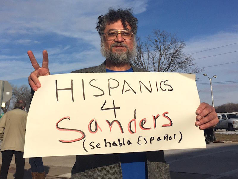 Sen. Bernie Sanders is trying to make up ground when it comes to connecting with minorities. Iowan Jorge Montes, seen here at a rally in Clinton, Iowa, says Sanders' stance on immigration and health care make him a good choice for Latino voters.