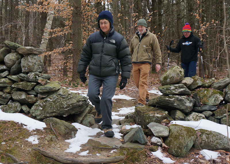 Williston Conservation Planner Melinda Scott, Vermont Land Trust Champlain Valley Regional Director Bob Heiser and Fellowship of the Wheel President Steve Fischer walk a trail in the new portion of Mud Pond Country Park.