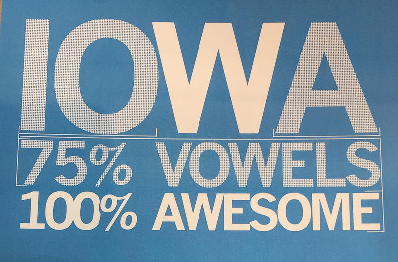 A postcard by Des Moines-based Raygun helps Iowans convey their state pride. When we asked you, our audience, what you wanted to know ahead of our trip to the Hawkeye State, you sent more than 100 questions via e-mail, Facebook, Twitter and Reddit.