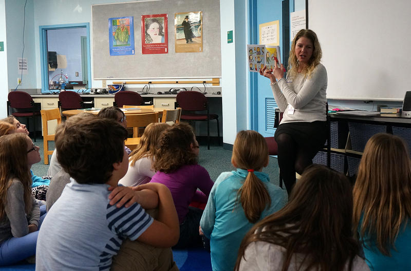Richmond Elementary School Librarian Beth Redford discusses 'El Deafo' with a group of fourth graders.