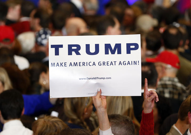 A Donald Trump supporter holds a sign during a South Carolina Republican primary night event on Feb. 20. A super PAC created by a white supremacist group made robocalls to Vermont households on Wednesday evening that urged people to vote for Trump.