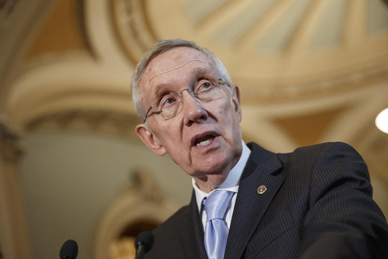 Senate minority leader Harry Reid, shown here in 2014, says he will not endorse either Hillary Clinton or Bernie Sanders ahead of this Saturday's Democratic caucuses in his state.