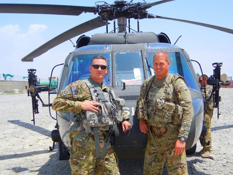 Contemporary instrumental composer Peter Jennison (left) stands in front of a UH-60 Blackhawk with fellow pilot CW4 Thad Hansen in Southeast Afghanistan.
