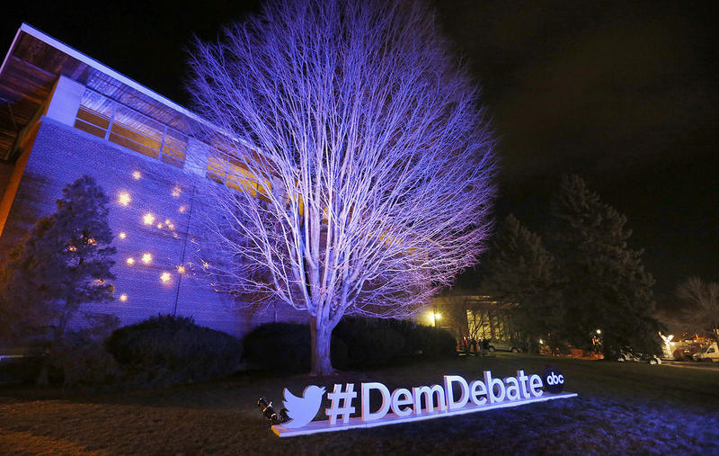 A tree and sign are illuminated during a Democratic presidential primary debate at Saint Anselm College in December. The Manchester college has hosted every single presidential candidate since Eisenhower in 1952.