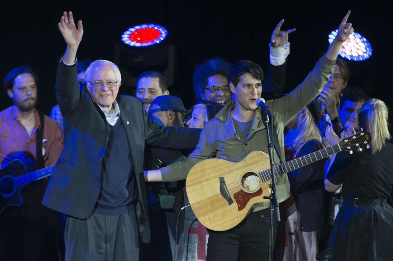 Sen. Bernie Sanders and Vampire Weekend lead singer Ezra Koenig wave during a campaign rally at the University of Iowa on Saturday, Jan. 30. The growing list of artists supporting Sanders forms an eclectic playlist.