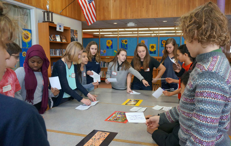 Students from Burlington's two middle schools played a matching game based on 'The Art of Secrets' to get to know each other before their book discussion.