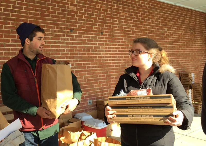 Charlie Mitchell and volunteer Eleanor Eagan are among the Middlebury students who help organize Middlebury Food, which sells pre-ordered combinations of produce, meats, eggs and cheese to food insecure families in Addison County.