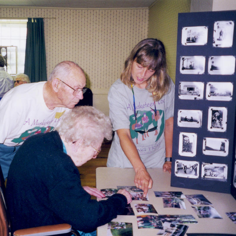 Cara Nelson sharing her 1997 Long Trail thru-hike with her grandmother Catherine Robbins's 1927 hike as one of the Three Musketeers. Rodney Robbins, Catherine's brother listens and observes.