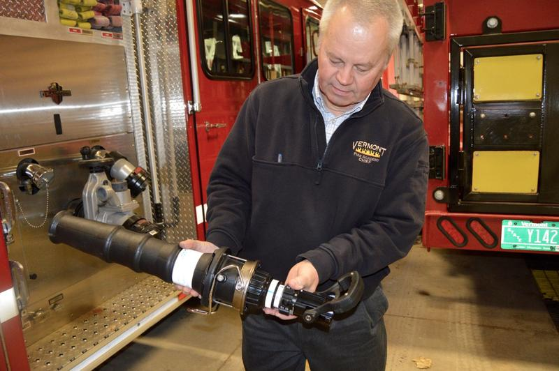 James Litevich, chief fire service training officer at the Vermont Fire Academy, holds one of several nozzles they use to spray fire retardant foam. Some foams contain the potentially harmful chemical PFOA.