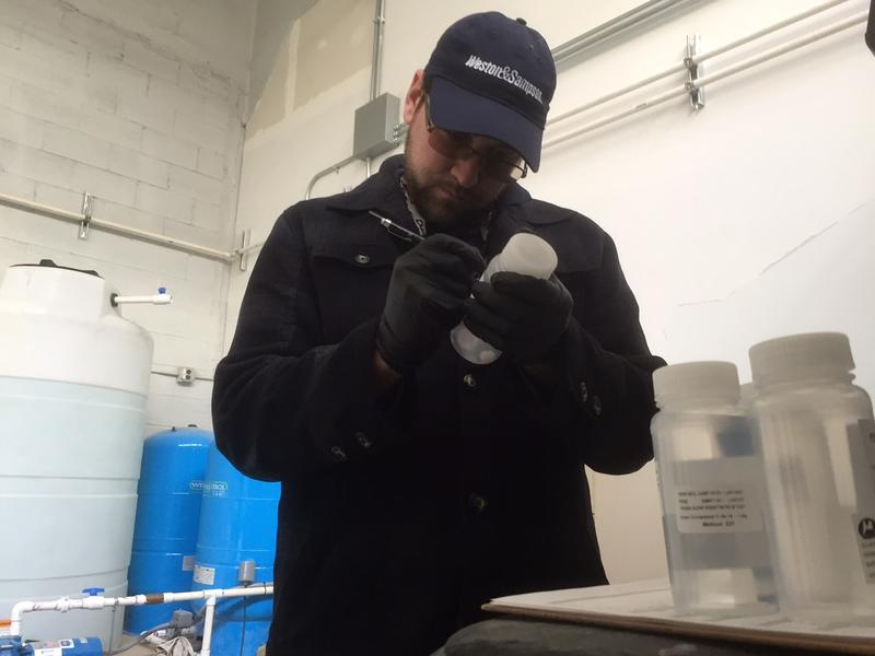 Brian Phillips does a water test in North Bennington. The state says it will test water around the state near suspected sites that used PFOA in manufacturing.