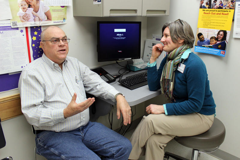 Ken Petersen visits his primary care physician, Dr. Alicia Jacobs, at UVM Medical Center's Colchester Family Practice to check in about his diabetes treatment. The practice is making major changes to become more proactive about preventative health care.
