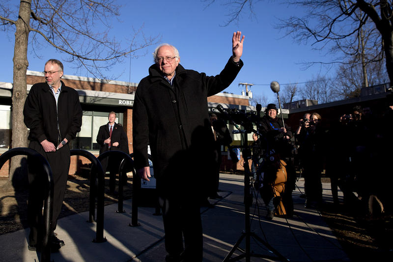 Sen. Bernie Sanders waves as he leaves a news conference after voting in the Vermont primary at the Robert Miller Community and Recreation Center in Burlington on Tuesday morning.