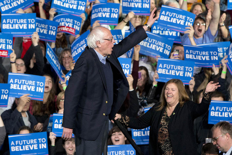 Sen. Bernie Sanders waves with his wife Jane Sanders as they arrive to a primary night rally in Essex Junction on Tuesday night. The Associated Press called a Vermont victory for Sanders at 7 p.m.