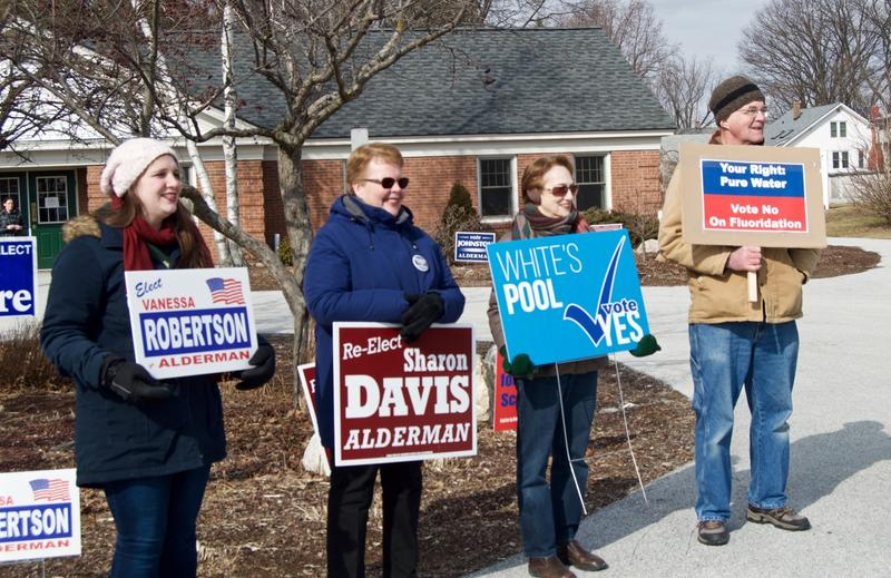 From left, Vanessa Robertson and Sharon Davis, who are running for seats on the Rutland board of aldermen, campaign outside the Godnick Senior Center.