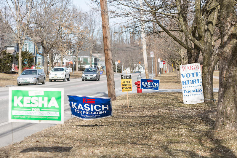 Campaign signs outside Mater Christi School in Burlington on Tuesday morning.