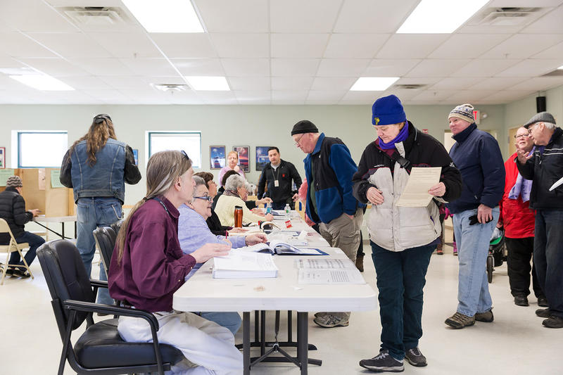 Voters cast their ballots at the Robert Miller Recreation Center polling location in Burlington on Tuesday morning.
