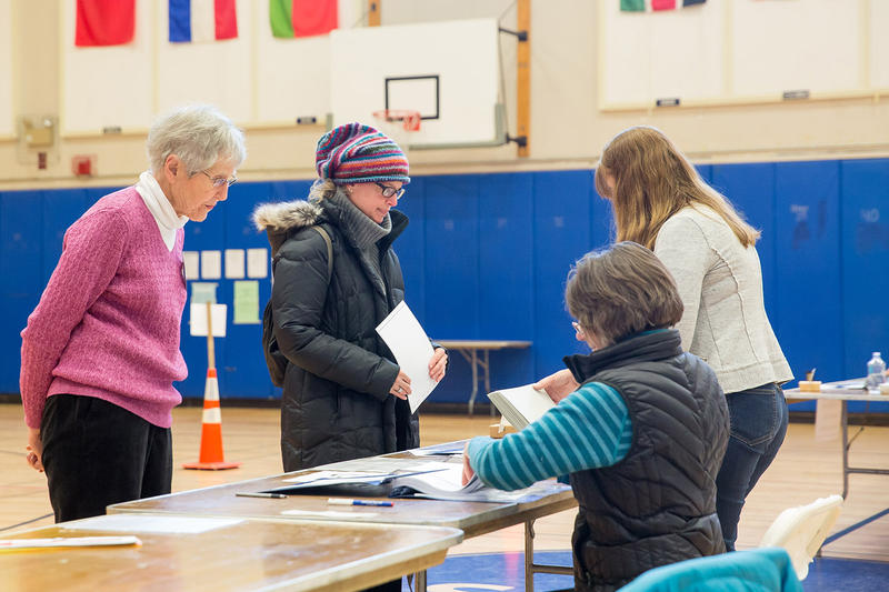 Residents from Burlington's Ward 6 check in to vote at the Edmunds Middle School polling location on Tuesday morning.