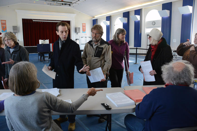 Voters pick up their ballots at Norwich's Tracy Hall on Tuesday morning. Mobile users: Tap this photo to view a slideshow.
