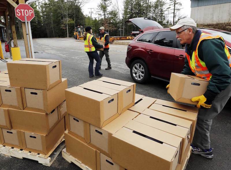 Earlier this month, state officials unload boxes of bottled water for those around Saint-Gobain's plant in Merrimack, N.H. The company is providing water for those within a mile of the plant or with more than 100 parts per trillion of PFOA in their water.