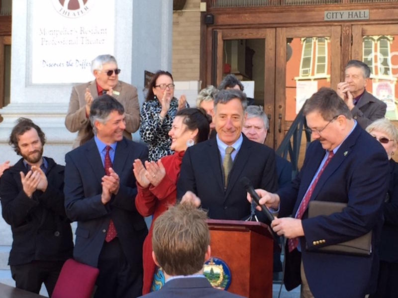 Gov. Peter Shumlin and Secretary of State Jim Condos outside Montpelier City Hall Thursday for the bill signing. The new law will automatically register Vermonters to vote when they get or renew a driver's license.