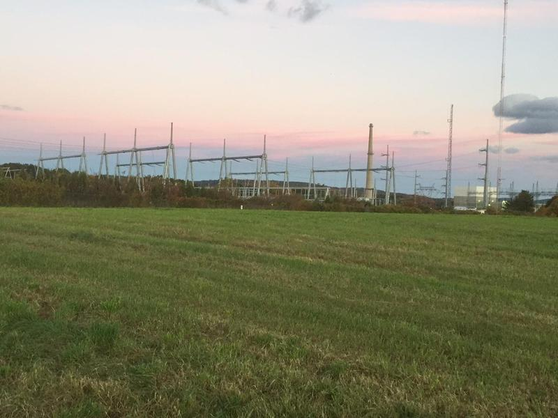 Developers say the switchyard outside Vermont Yankee would have supported a 600-megawatt natural gas power plant. But plans to build a pipeline near the site were suspended Wednesday.