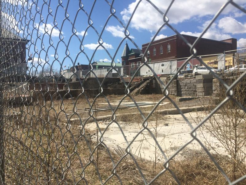 The Renaissance Block Redevelopment Project is only a blasted-out empty lot on Main Street in downtown Newport. Following fraud allegations against two NEK developers, the future of the project, which was supposed to revitalize the town, is uncertain.