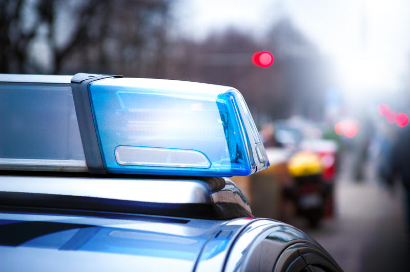 A stock photo close up of the blue lights atop a police cruiser.