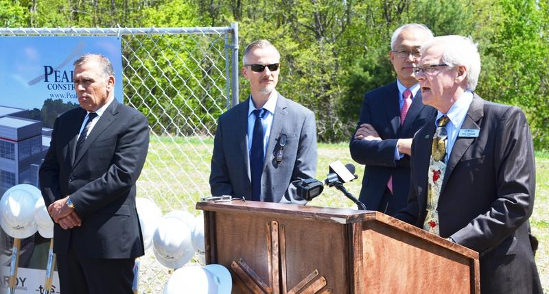 Ariel Quiros, seen far left at a 2015 press conference, used the EB-5 program to defraud foreign investors. Attorney General TJ Donovan announced Thursday that he'll pay $2 million to settle civil charges filed by the state in 2016.