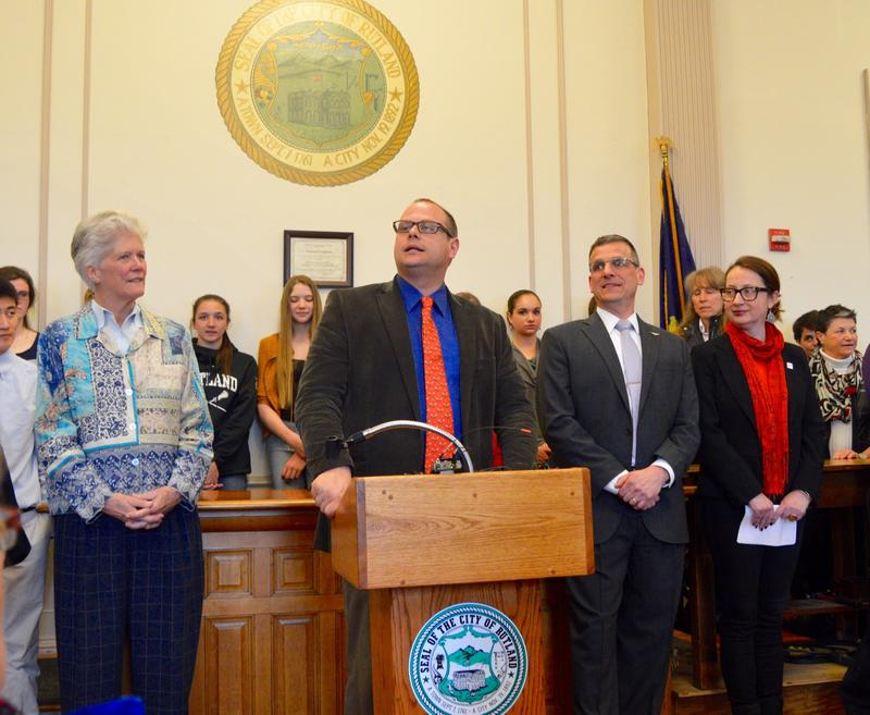 Rutland City Board of Aldermen President William Notte speaks at a crowded press conference Tuesday where city officials announced 100 Syrian refugees would be resettled in Rutland beginning in October.