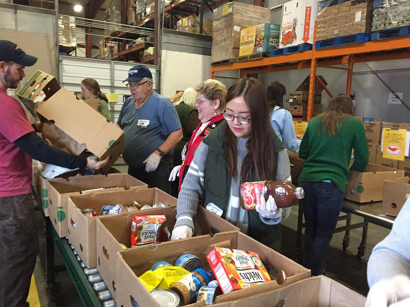 "Vermont Foodbank volunteers sort through salvaged food. The state's new universal recycling law is diverting much more food from landfills than expected, and the organization's ""food rescue"" is up 30 percent."