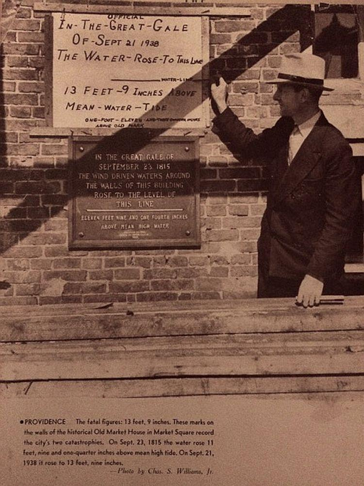 Raymond LaPorte worked for the Providence, Rhode Island, water department in 1938. In this photo, he points out the high watermark of the storm in downtown Providence.