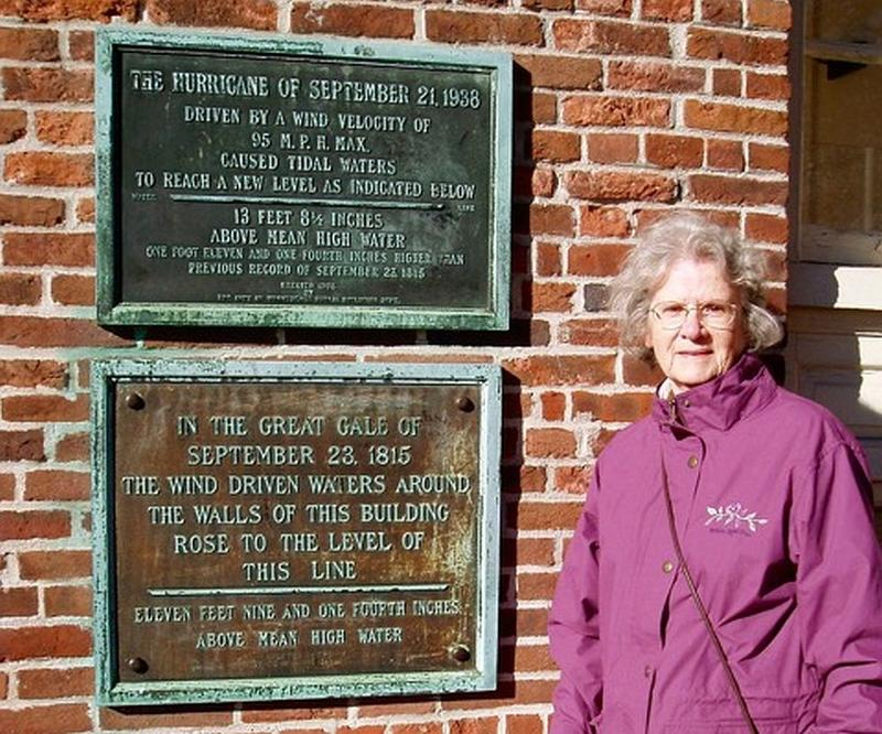 LaPorte's daughter, Shirley LaPorte Russillo, stands at the same spot in 2004, where a plaque commemorates the storm.