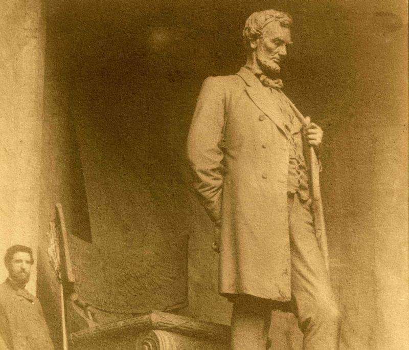"Augustus Saint-Gaudens stands next to his monumental ""Standing Lincoln."" The Saint-Gaudens National Historic Site is looking for relatives of Langdon Morse, the Vermont man who modeled for the statue."