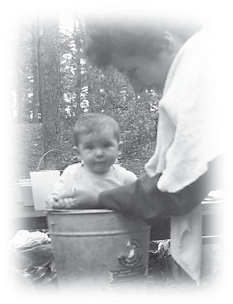 Dana Walrath, in a bucket, with her mother Alice.