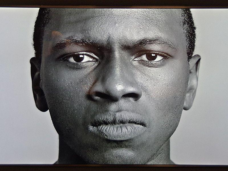 "Todd Lockwood's still portrait of two-time Vermont Poetry Out Loud winner Claude Mumbere for Lockwood's new exhibit, ""Cinema Portraits,"" on display now at Champlain College."
