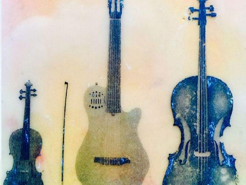 The trio Yellow Sky, which uses this encaustic-treated photograph of its instruments as an emblem, will be performing original compositions for strings, inspired by the works of Stephen King, in Montpelier on June 18.